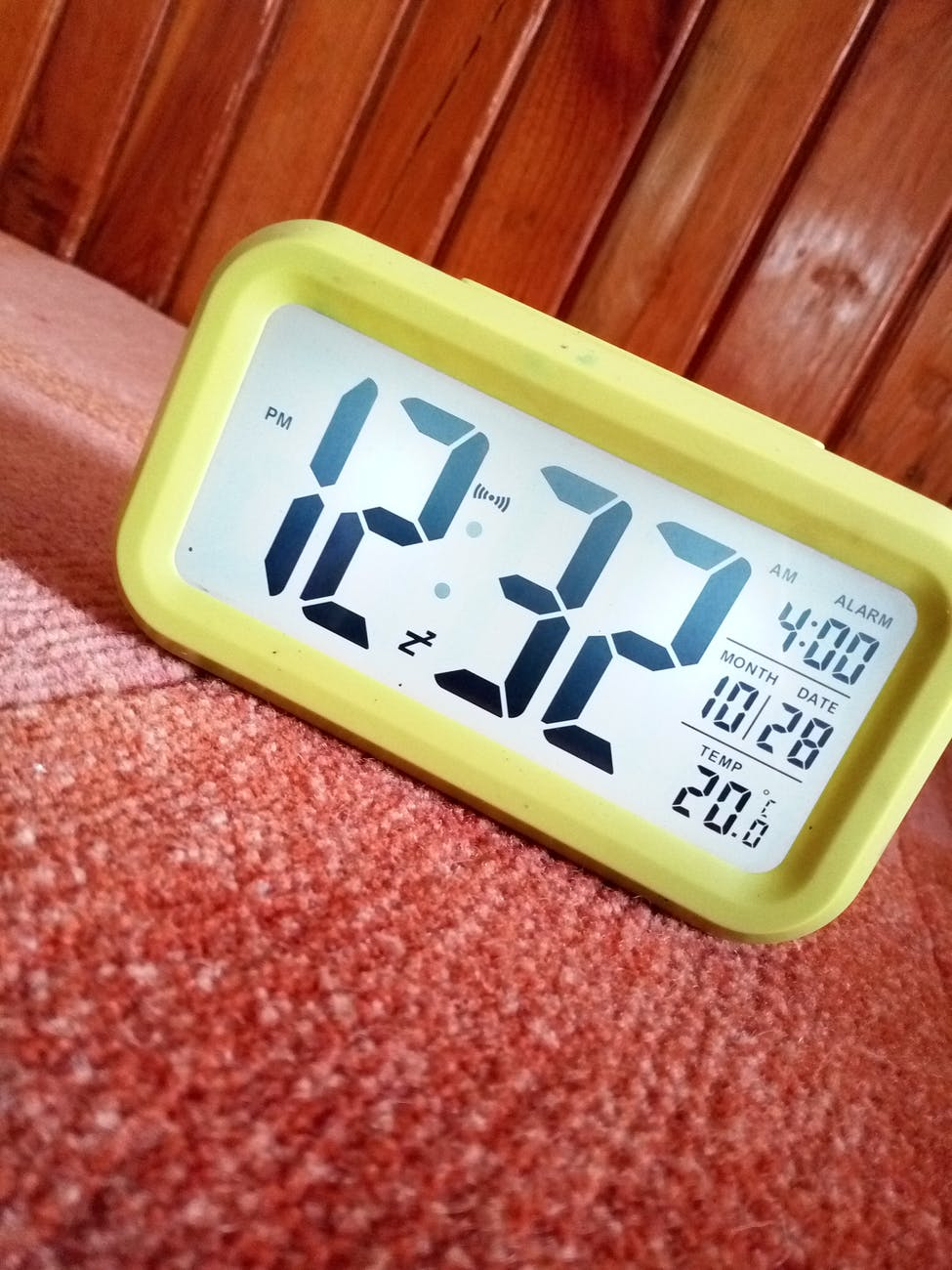 close up photography of yellow alarm clock
